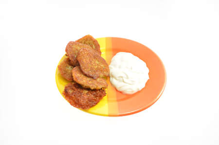 potato pancakes with smeranoy on a plate on a white background photo