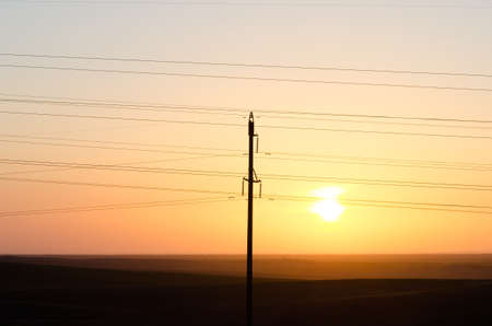 transmission line on the background of the sunset photo
