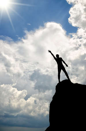 man on top of the mountain reaches for the sun Stock Photo - 14007724