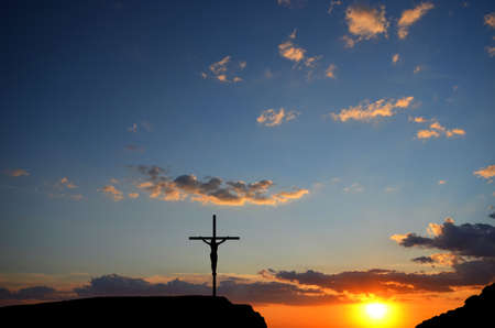 Crucifixion of Jesus Christ on the cross on a background sunset photo