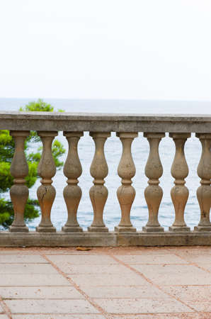 banister: seascape visible through old columns