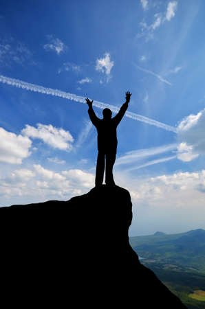 man on top of the mountain reaches for the sun Stock Photo - 16654618