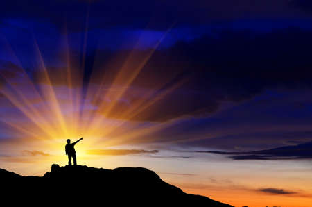 man on top of the mountain reaches for the sun Stock Photo - 16852372