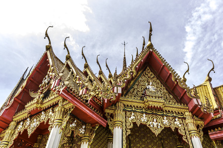 arched: Thai Buddhist arched entrance against with blue sky Stock Photo