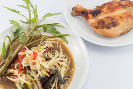 somtum: Papaya salad and Grilled Chicken Stock Photo