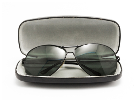 sunglasses: sunglasses in black opened case isolated on white background