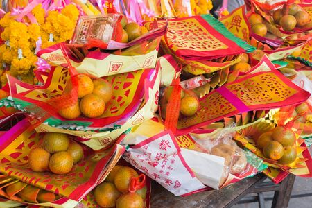 Pattern of Joss Paper and Orange , Chinese or Lunar new year for Sacrificial offering Chinese Culture.