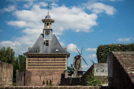 The Dalempoort in Gorinchem, Holland, seen from the city walls. In the background windmill De Hoop.