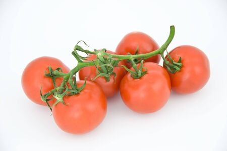 A tomato ripe isolated on white background. Stock Photo