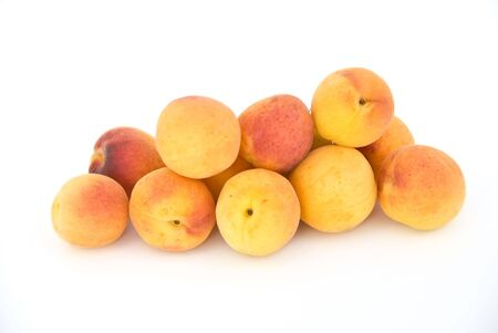Some apricots meet them in the lightbox. Isolated on white.