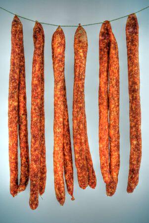 Hdri of some sausages hanging on hook.