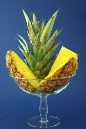 Pineapple branch and slices in a glass dish. Stock Photo - 3180948