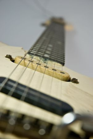 A heavily used electric guitar. Focus on 2nd pickup. Stock Photo