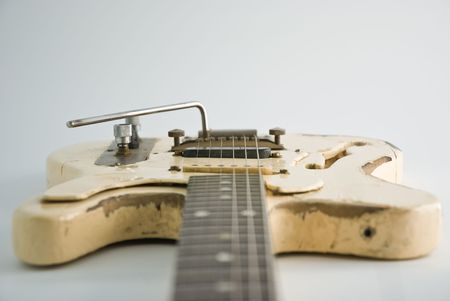 A heavily used electric guitar. Focus on black pickup. Stock Photo - 3190722
