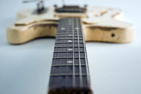 A heavily used electric guitar. Focus on 5th fret. Stock Photo