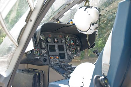 The cockpit of a rescue helicopter with pilot helmets. Stock Photo