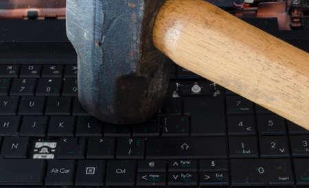 sledge hammer: Sledghammer on Computer Keyboard Stock Photo
