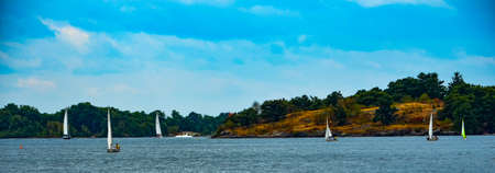 lawrence: Sailboats near an island in the St. Lawrence River