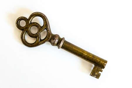 skeleton key: Antique Brass Skeleton Key closeup on a white background