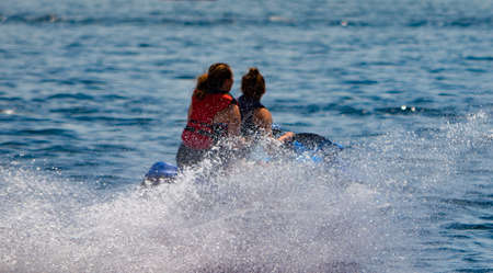 lawrence: Two people jet-skiing on the St. Lawrence River in the Summer
