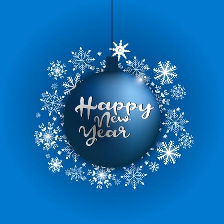 Happy new year inscription on a blue christmas ball.