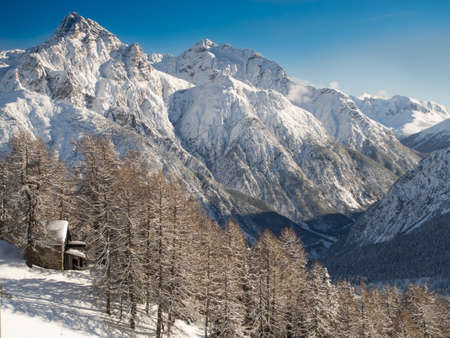 deep powder snow: Ski lift in front of the panorama of the Sesvenna mountain group,Engadine, Switzerland