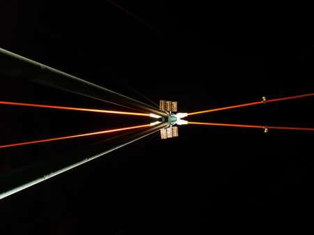 Part of modern bridge with attractive illumination in Frankfurt, Germany photo