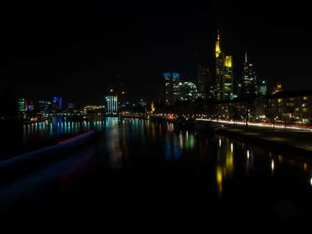 river main: Lights of a ship on the River Main and the skyline of Frankfurt, Germany, at night