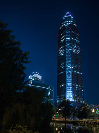 trade fair: Trade Fair Tower, Messeturm, in Frankfurt, Germany, by night Stock Photo