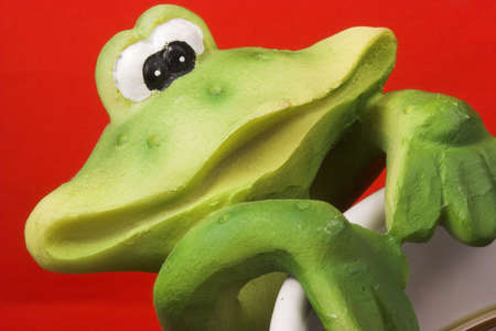 affinity: Frog smile having coffee Stock Photo
