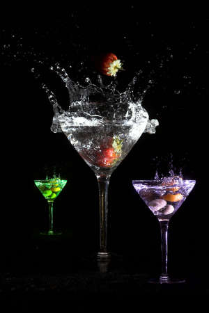 Three martinis in different colors and with different ingredients photo