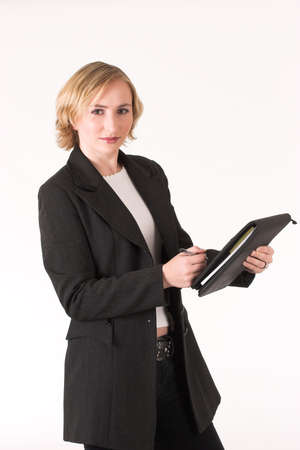 ledger: Female inspector with ledger making notes Stock Photo