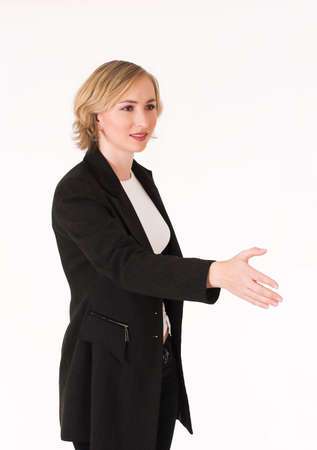 concluding: Business woman concluding deal with handshake, offer to shake hand Stock Photo