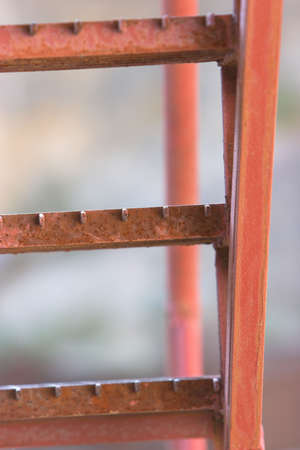 Ladder going upwards, close-up of the orange steps Stock Photo - 584628