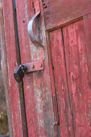 Old red toolshed door locked and rusted Stock Photo - 584638