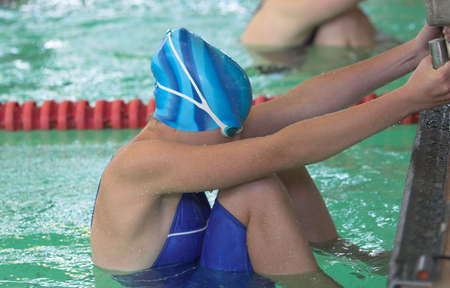 Young women on starting block ready for backstroke Stock Photo - 733732
