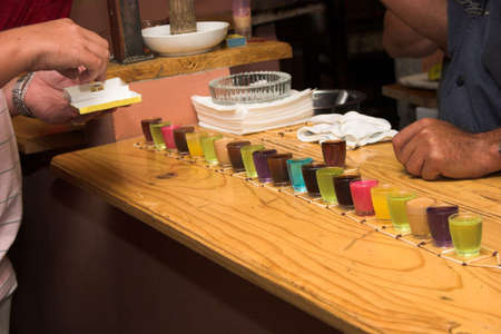 shooters: Drinking games in a bar with colourful shooters