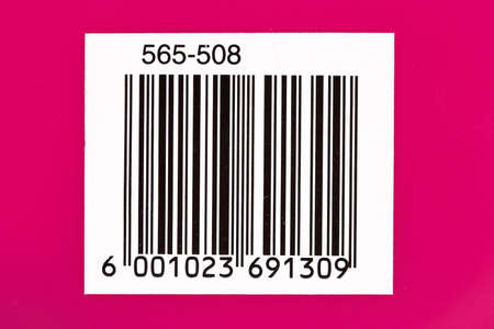 Used barcode on a pink background with numbers photo