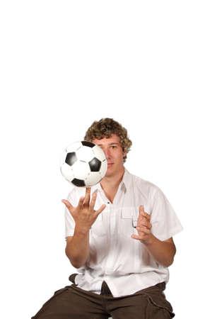 finger tip: Soccer player spinning football on finger tip