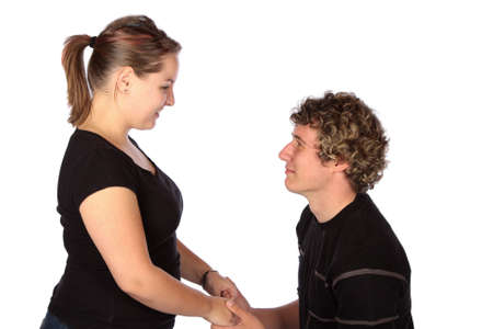 Young man proposing to his girlfriend to get married