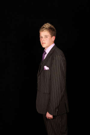 Side view of young attractive male model in pinstriped suit photo