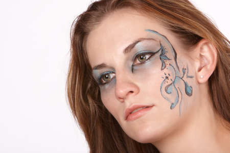 far off: Dreamy far off expression in fantacy makeup model with long brown hair Stock Photo