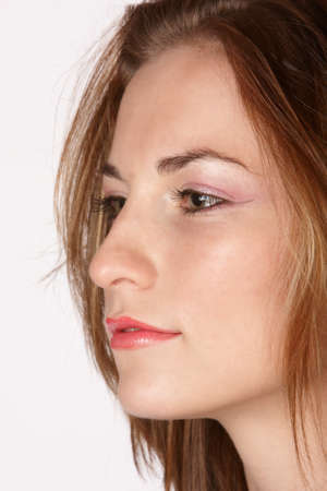 profile of mode lwith pink eye shadow and brown hair photo