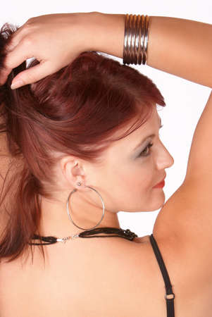 glancing: Young female glancing back over shoulder and lifting hair up