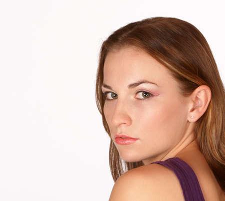 glancing: Young attractive brunette glancing over left shoulder