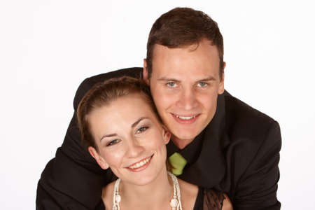 informal clothing: Young couple in formal dress holding each other in love