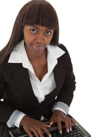 Young black female executive typing on laptop photo