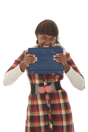 handbook: Young black female student frustrated and clutching handbook isolated
