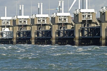 windy energy: Storm surge barrier in Zeeland, Netherlands. Build after the storm disaster in 1953. Stock Photo