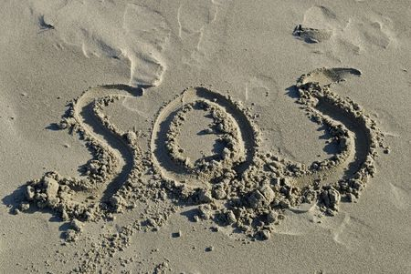 СОС: SOS Inscription On A Sand Beach